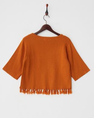 オレンジ  裾フリンジニットプルオーバー見る