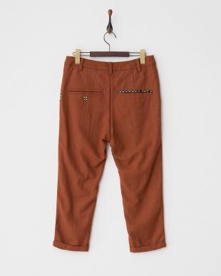 オレンジ ウール混ドット使い裾ダブルパンツ見る
