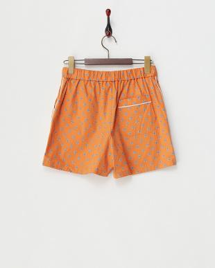 オレンジ  小紋柄ショートパンツ見る