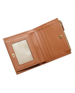BROWN スナップボタン付き地図柄二つ折財布見る