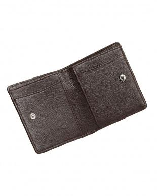 ニコチン  オーストリッチパッチワークコンパクト財布見る