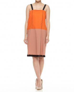 オレンジ系 裾サークルモチーフ付きバイカラーワンピース見る