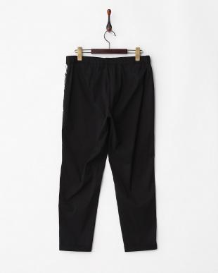 ブラック×ホワイト RIBELLE・leggings リーフ柄 前後切替パンツ見る