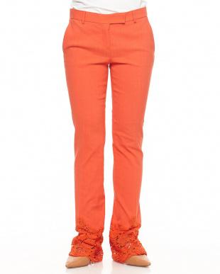 オレンジ 裾レース リネン混パンツ見る