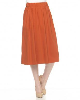 オレンジ uts パイピングスカート見る