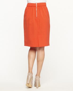 オレンジ タックコクーンスカート見る