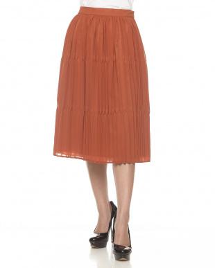 ダークオレンジ ランダムプリーツスカート見る