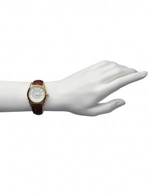 ゴールド/ホワイト  ダイヤ付き ソーラー電波腕時計 085 WOMEN見る