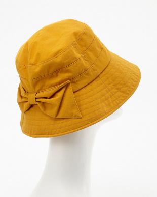マスタード  リボンモチーフ付き帽子見る