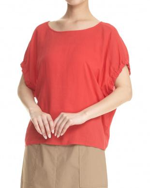 オレンジ  バック裾リボン ゴムギャザー袖ブラウス見る
