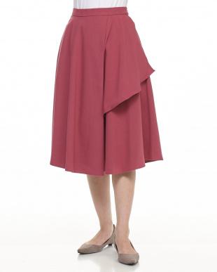 ピンクベージュ イレギュラーヘムラップ風スカート見る